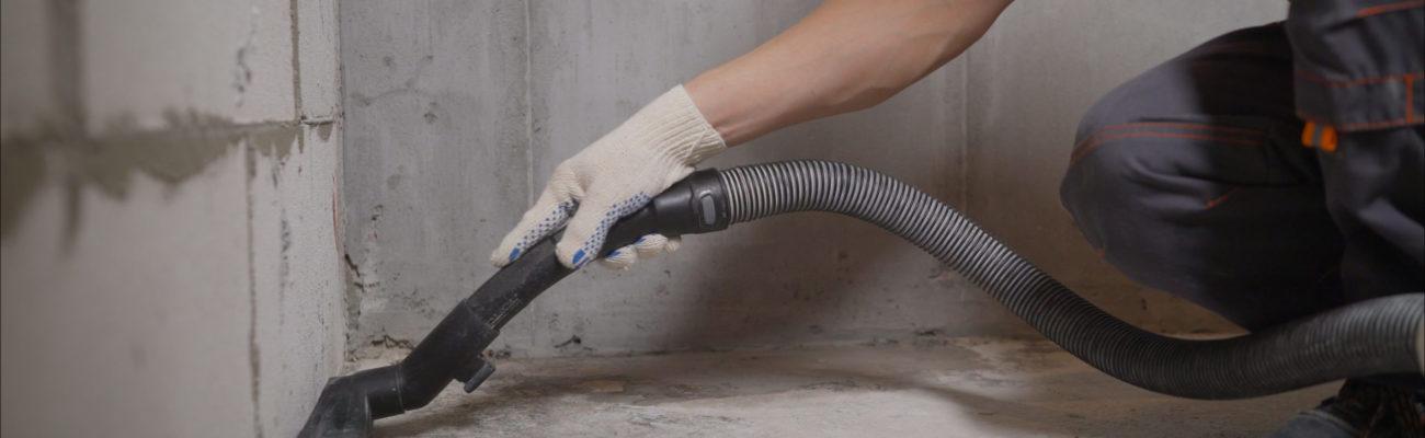 Worker,Vacuuming,Concrete,Floors.,Preparing,The,Floor,For,Waterproofing.,Construction